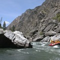 A paddle boat gives some perspective on the true size of Clamshell Rock.- Middle Fork of the Salmon River - Day 6