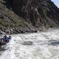 A 22-foot sweep boat takes on the big diagonal wave in Rubber Rapid at 6 feet.- Middle Fork of the Salmon River - Day 6