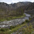 Upper Powerhouse Rapid and the fire scars from the 2008 wildfires.- Middle Fork of the Salmon River Trail – Day 1