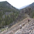 A group of hikers makes a descent through talus fields back down to the river near Big Bend Camp.- Middle Fork of the Salmon River Trail – Day 1