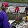 Hikers take a lunch break at the Trail Flat Hot Spring.- Middle Fork of the Salmon River Trail – Day 1