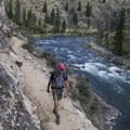 Hiking through the narrow gorge above Aparajo Rapid (RM 63.1) where the trail has been blasted out of solid rock.- Middle Fork of the Salmon River Trail – Day 5
