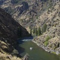 A commercial sweep boat drifts through the pool at the end of the Grouse Necks.- Middle Fork of the Salmon River Trail – Day 5