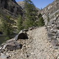Impressive rock work keeps the trail in place across several talus slopes.- Middle Fork of the Salmon River Trail – Day 6