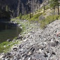 The shade creeps down to the river late in the afternoon on day six.- Middle Fork of the Salmon River Trail – Day 6