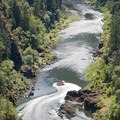 A commercial Jet Boat does a high speed spin in front of the Paradise Lodge dock.- Rogue River: Grave Creek to Foster Bar