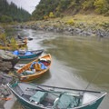 Driftboats anchored for access to Black Bar Lodge.- Rogue River: Grave Creek to Foster Bar