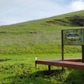 Take a rest at the information bench.- Lynch Canyon Open Space