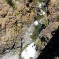 A side trip up the Mule Creek Canyon Trail is worth the effort. This photo is from the bridge spanning a confluence up Mule Creek.- Rogue River Trail – Day 2