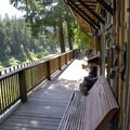 The riverside deck at Paradise Lodge, an evening stopping point for lodge-based hikers along the Rogue.- Rogue River Trail – Day 3