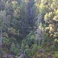 A view onto several waterfalls opposite the trail at Fall Creek.- Rogue River Trail – Day 3