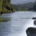 A jetboat heads upstream in the later afternoon light.- Rogue River Trail – Day 3