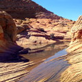 Water has created the troughs and low spots in the sandstone.- The Wave