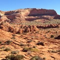 Looking east across North Coyote Buttes at a mid-point in the hike.- The Wave
