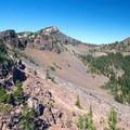 The trail runs along a steep slope on the way to Slide Lake.- Slide Lake via High Lake