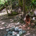 An overnight area near the falls. Unfortunately, litter and trash can be substantial in the area.- Explorer Falls
