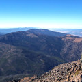 A hiker enjoys the summit view.- Strawberry Mountain via Strawberry Lake