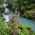 The Boulder River runs a chalky blue with snowmelt in the spring.- Boulder River Trail