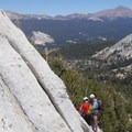 Looking back towards Tuolumne Meadows and Lembert Dome from the base.- Cathedral Peak: Southeast Buttress