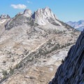 Cathedral Peak's Southeast Buttress in the shadow with Echos Peaks beyond, as seen from the descent.- Cathedral Peak: Southeast Buttress