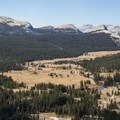 Tuolumne Meadows as seen from the top of Lembert Dome. Cathedral Peak (10,912'), left, towers above.- Tuolumne Meadows