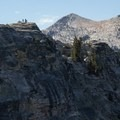 Hikers explore the summit of Lembert Dome. - Tuolumne Meadows