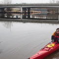 A kayaker prepares to launch from Rhododendron Park along the Sammamish River.- Sammamish River Kayak/Canoe