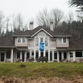 One of the many large houses that line the banks of the Sammamish River.- Sammamish River Kayak/Canoe