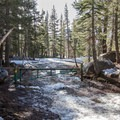 The gate that marks the end of the parking area and the trailhead.- Andesite Peak