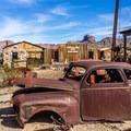"""The """"ghost town"""" buildings are clustered along short gravel and wooden paths. Many old vehicles and pieces of mine equipment are there as well.- Castle Dome Mines Museum and Ghost Town"""