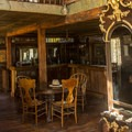 Many of the buildings are packed with period furniture and household items. This is the lobby of the hotel building.- Castle Dome Mines Museum and Ghost Town
