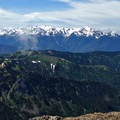 Mount Olympus (7,979') and Mount Carrie (6,995') rise in the distance beyond the Hurricane Ridge visitor center.- Mount Angeles Via Switchback Trail