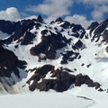 The hulking Anderson Massif. Left to right: West Peak (7,365'), Echo Rock (7,100'), Mount Anderson (7,329'). Anderson Glacier nestles below Echo Rock and Mount Anderson.- Anderson Glacier via Enchanted Valley