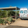 Some of the campsites have shade shelters for a tent or table.- Twin Peaks Campground