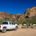 Trailhead parking and informational exhibits.- Arch Canyon Trail
