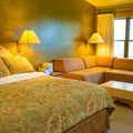 Lodge with king bed.- Sun Mountain Lodge