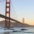 Larger west swells wrap in under the Golden Gate serving up waves at Fort Point. - Golden Gate Bridge + Fort Point