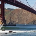 Boogie boarder dropping in at Fort Point.- Golden Gate Bridge + Fort Point