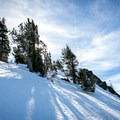 The approach to Castle Peak requires a steep climb.- Castle Peak + Basin Peak