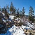 Seasonal creeks may cause some patchy areas in the snow along the trail.- Donner Peak + Mount Judah