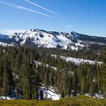 The slopes of Sugar Bowl Ski Resort are visible to the west.- Donner Peak + Mount Judah