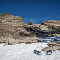 Removing snowshoes for the final scramble to Donner Peak.- Donner Peak + Mount Judah