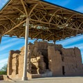 The main ruin is protected from the elements by a large roof structure.- Casa Grande Ruins National Monument