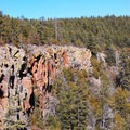 The Overlook crag as seen from the Oak Creek viewing platform.- The Overlook