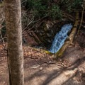 Looking down at the dam and the cascade below from the powerhouse ruins.- Catawba Falls