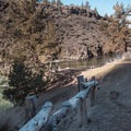 Railings ease the path down to the viewing and cliff jumping area. - Steelhead Falls