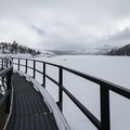 Crossing the spillway at the edge of a frozen Caples Lake.- Emigrant Lake Trail
