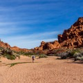 The first mile of the trail is down a wide, sandy wash.- Natural Arches Trail