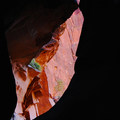 Peering out of the darkness near the end of the slot canyon.- Pine Creek Canyoneering