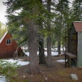 Hut and outhouse.- Ludlow Hut